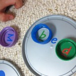 building words with letter lids