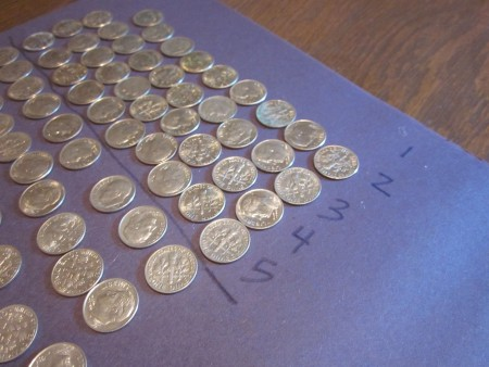 playing with money: counting, wrapping, estimating coins