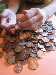 playing with money: counting, wrapping, estimating coins - teach mama