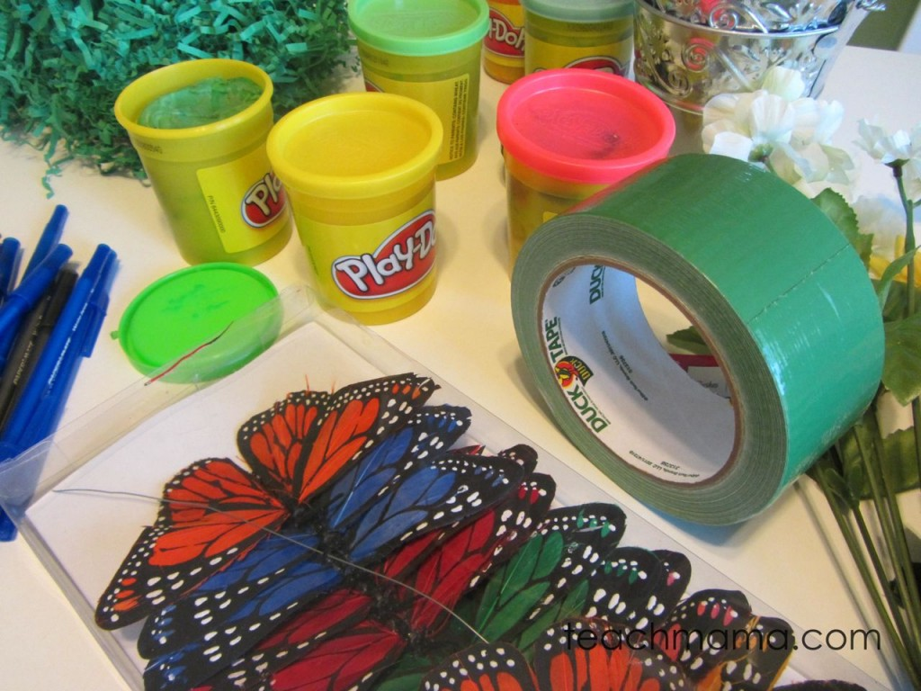 supplies on table for butterfly pens