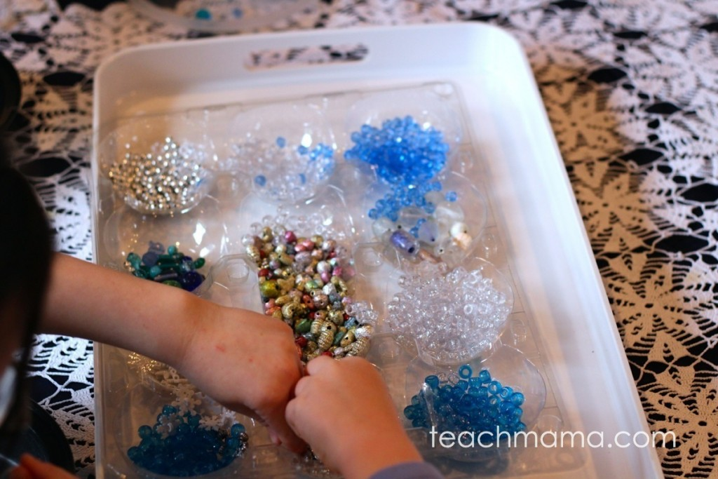 fancy blue, silver, white beads on a white tray