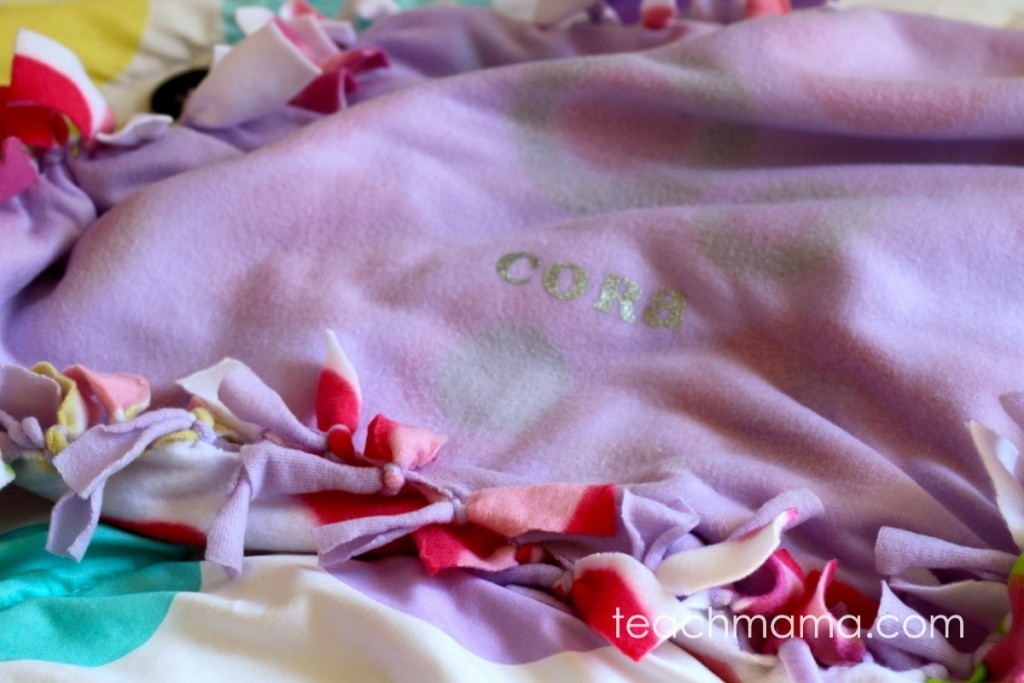 cora's name on a purple fleece blanket