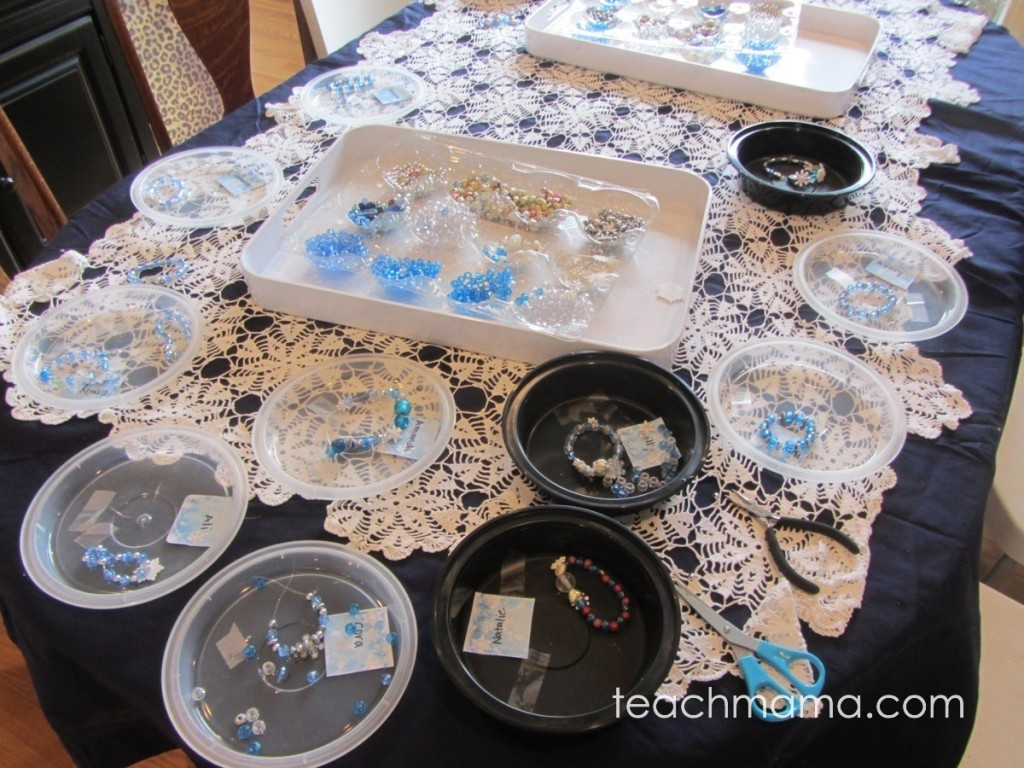 beaded bracelets on table, each on tray
