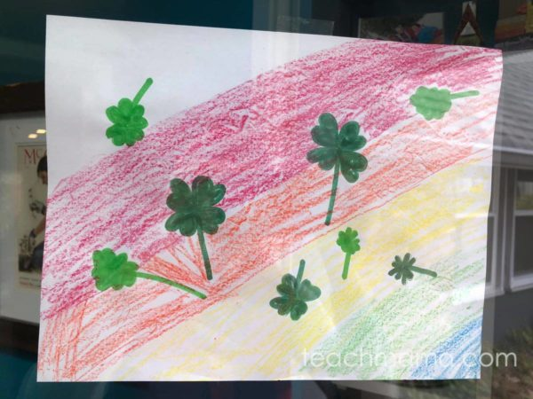 drawn picture with rainbow and shamrocks