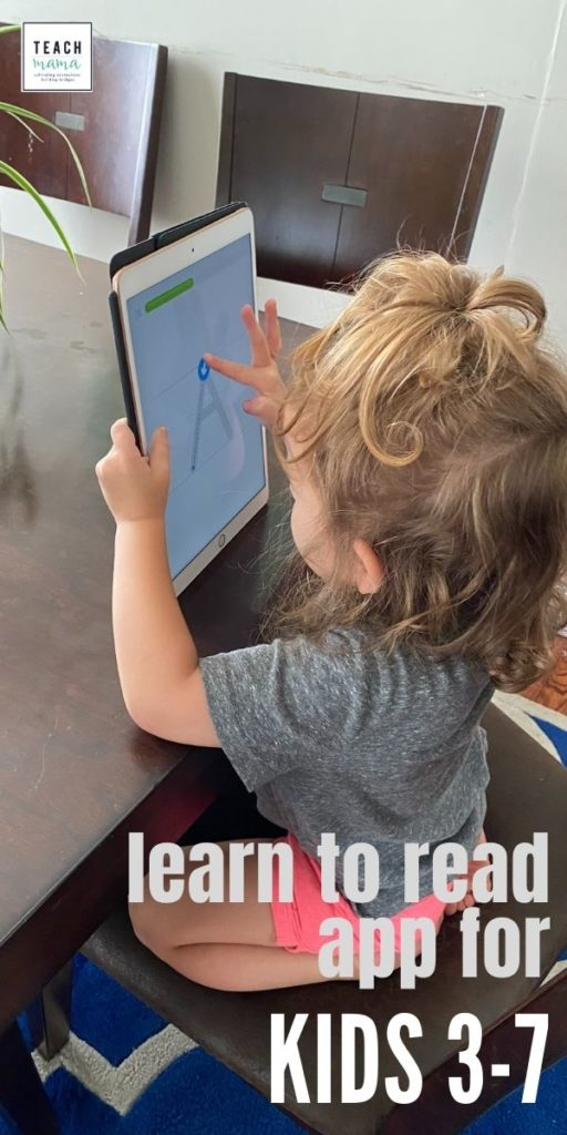 little girl playing with duolingo abc app