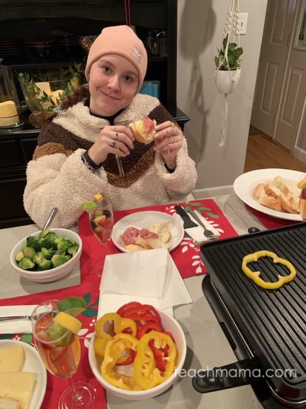 girl enjoying raclette meal