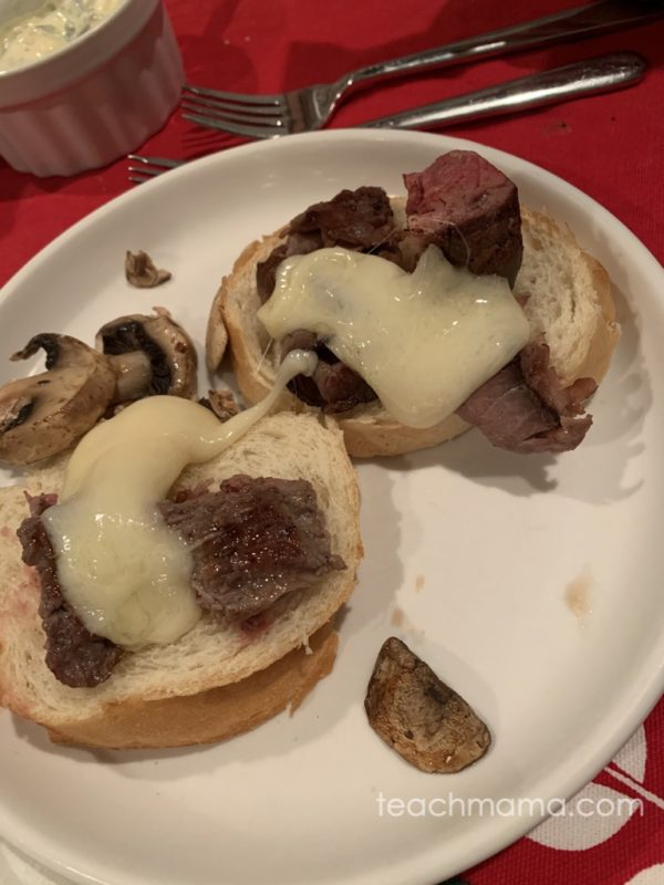 bread with melted raclette cheese and meat