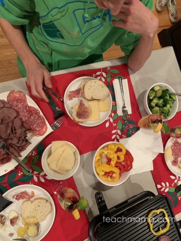 person with raclette food
